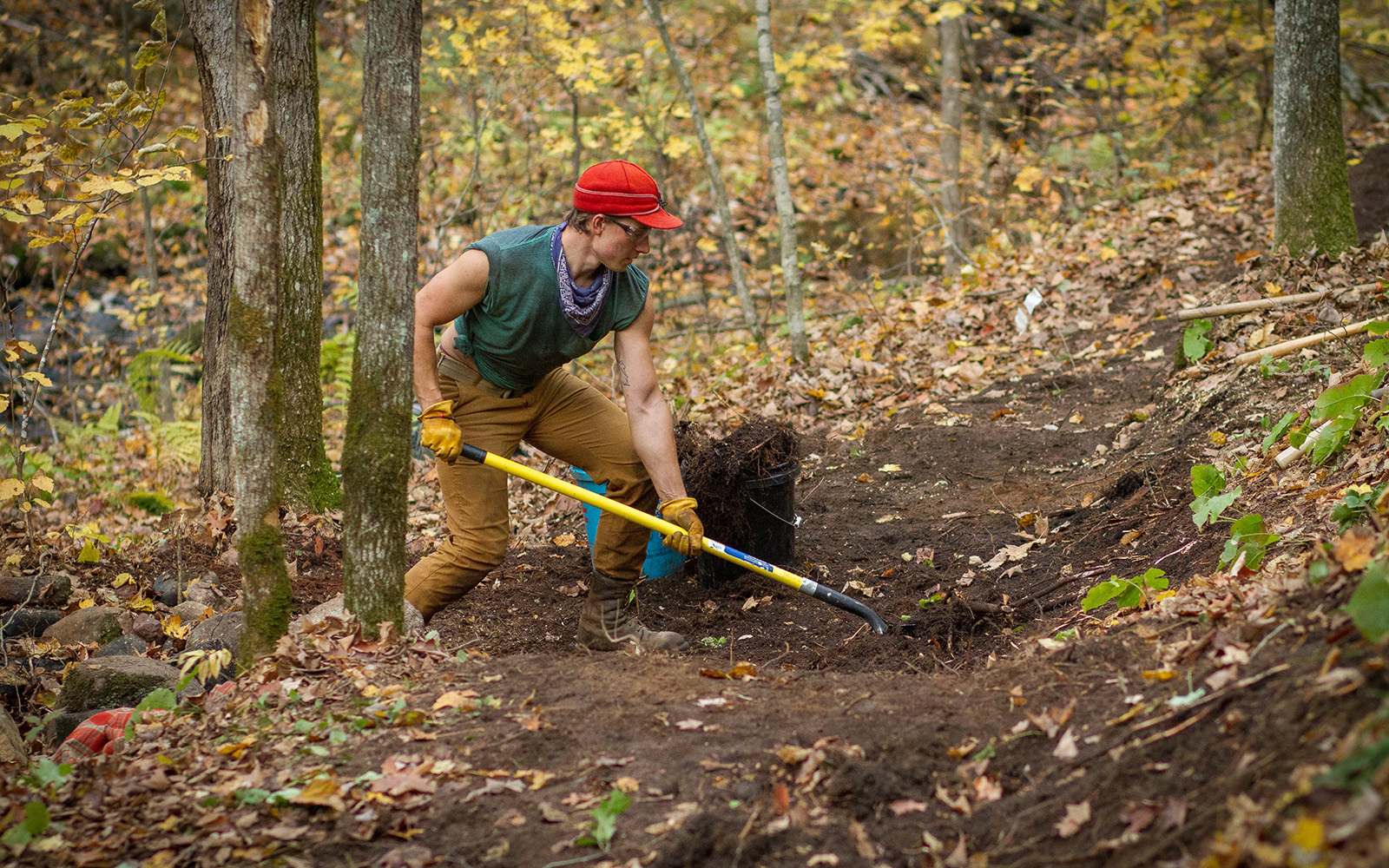 Northland College students digs trench on Ice Age Trail.