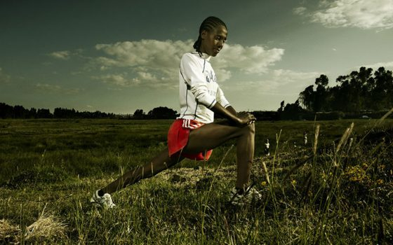 Ethiopian girl stretches before running (Girls Gotta Run Foundation)