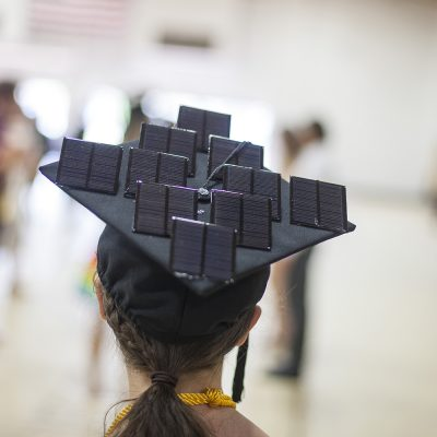 Northland College graduation cap decorated with solar panels