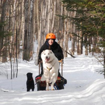 Northland College student Gretchen Hamernik-Winters dogsledding as part of internship.