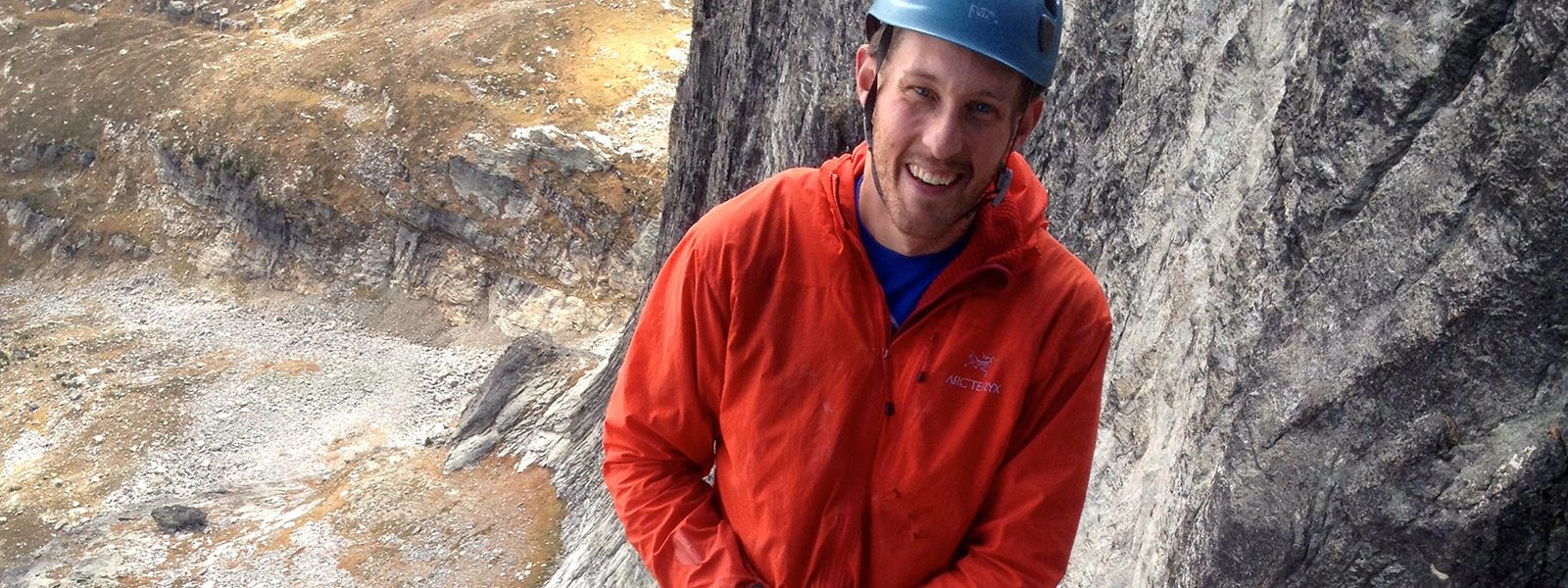 Northland College alum Jason Luthy on a climb