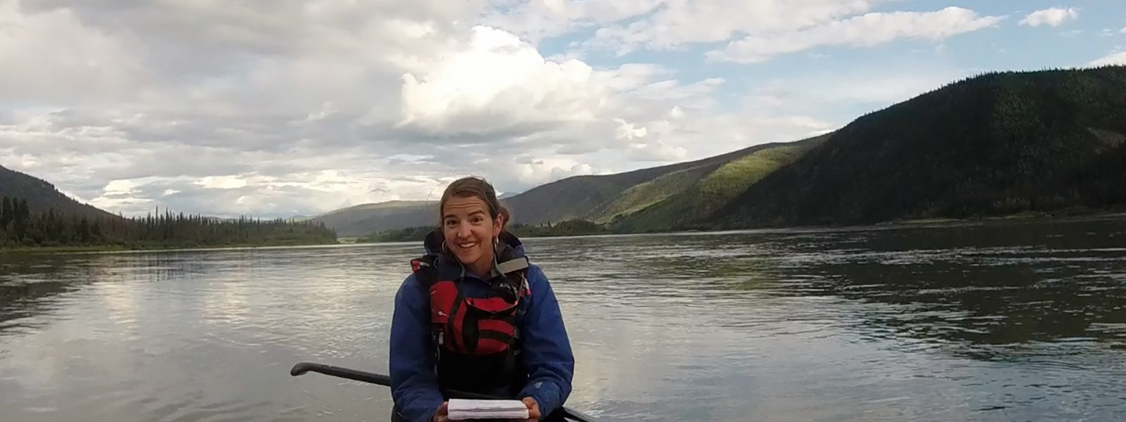 Northland College alum Mitzi Peine paddling a canoe