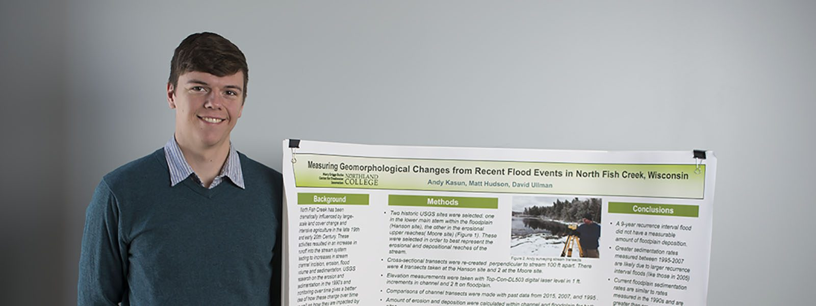 Northland College student Andy Kasun stands with his winning academic poster