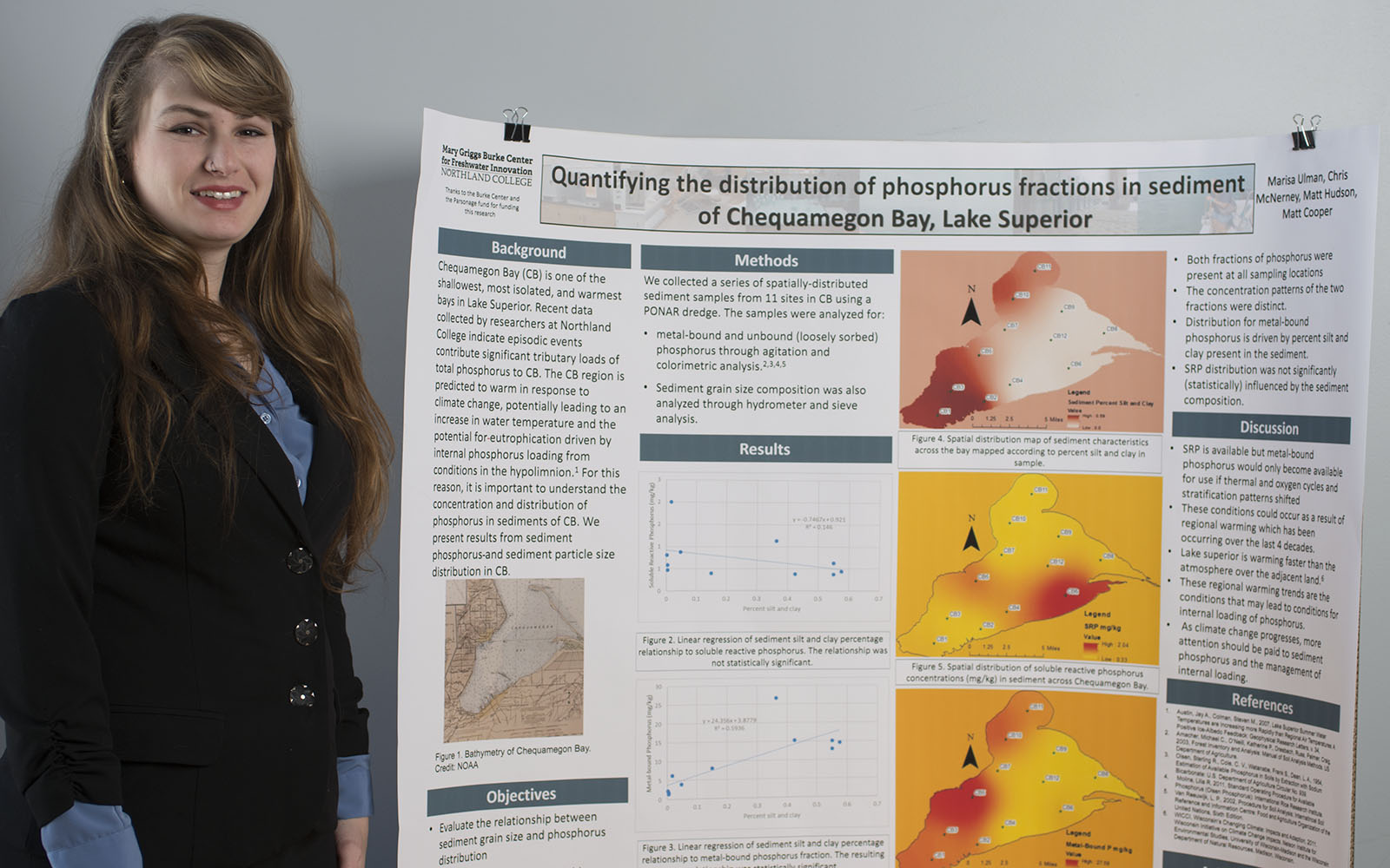 Northland College student Marisa Ullman stands next to her winning academic poster