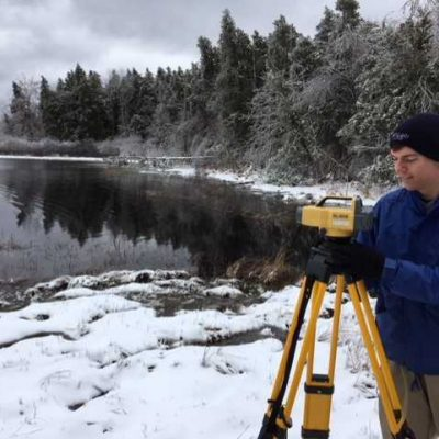 Northland College student surveys Fish Creek.