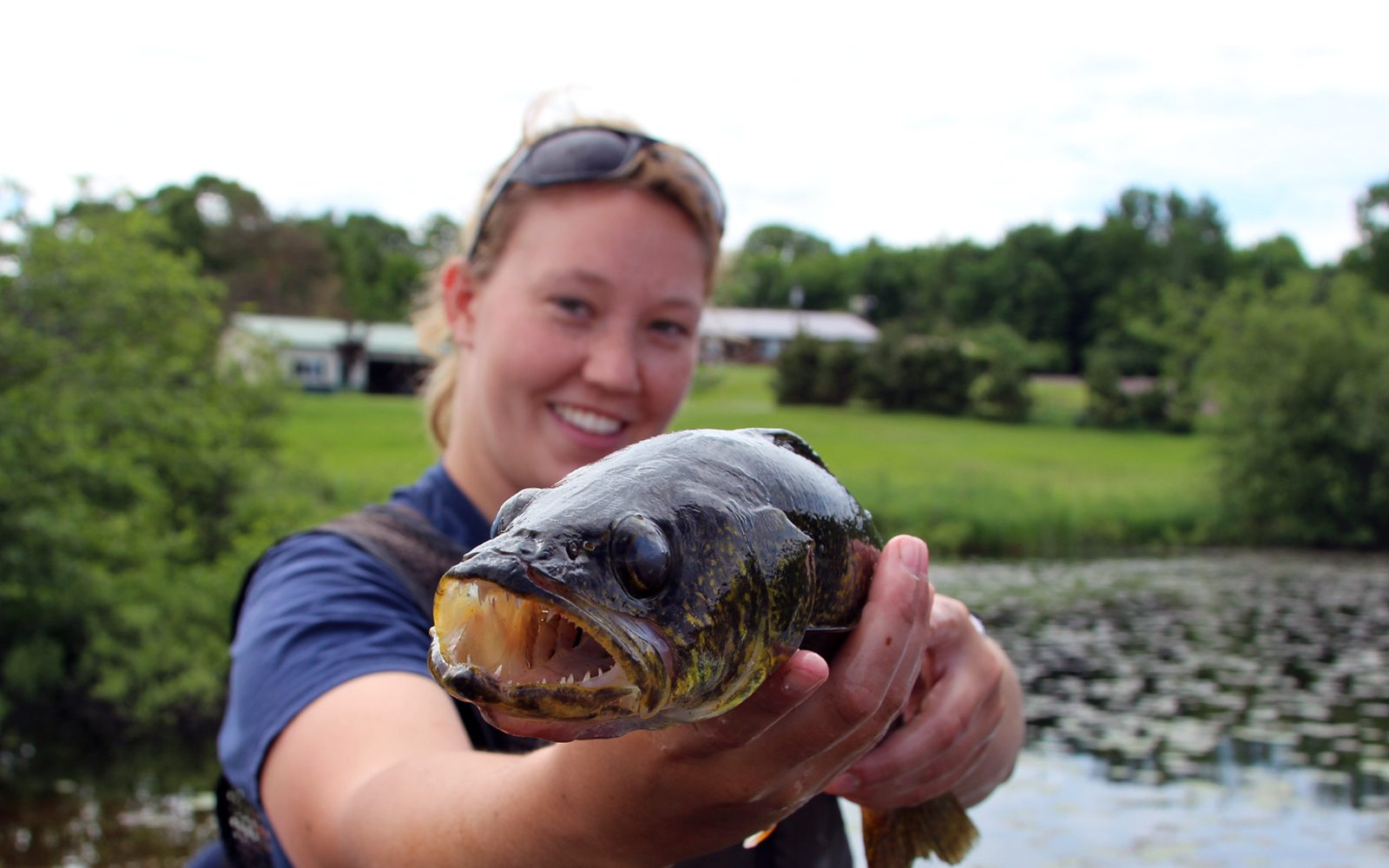 Northland College student Megan Made holds up a fish