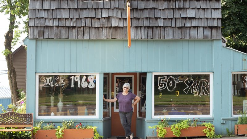 Northland College graduate Karlyn Holman poses in front of Karlyn's Gallery.