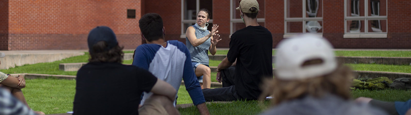 Northland College Diversity Coordinator Ruth deJesus teaches a session outdoors.
