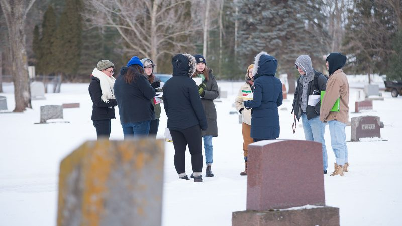 Northland College sociology class meets at cemetery to collect data.