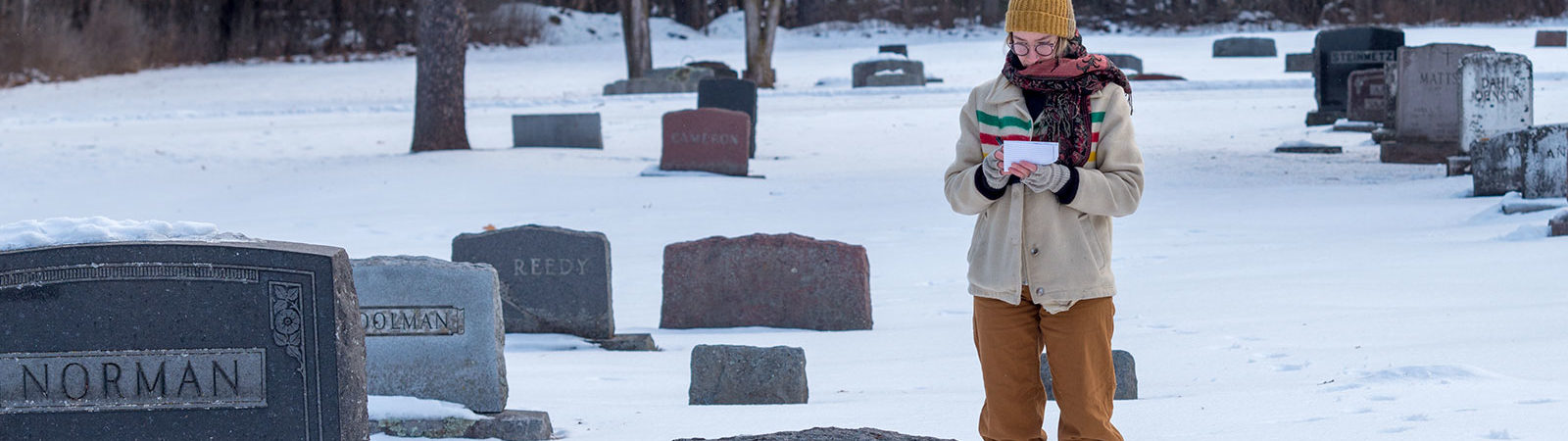 Northland College student Lily Sevilla collects data at Ashland Cemetery