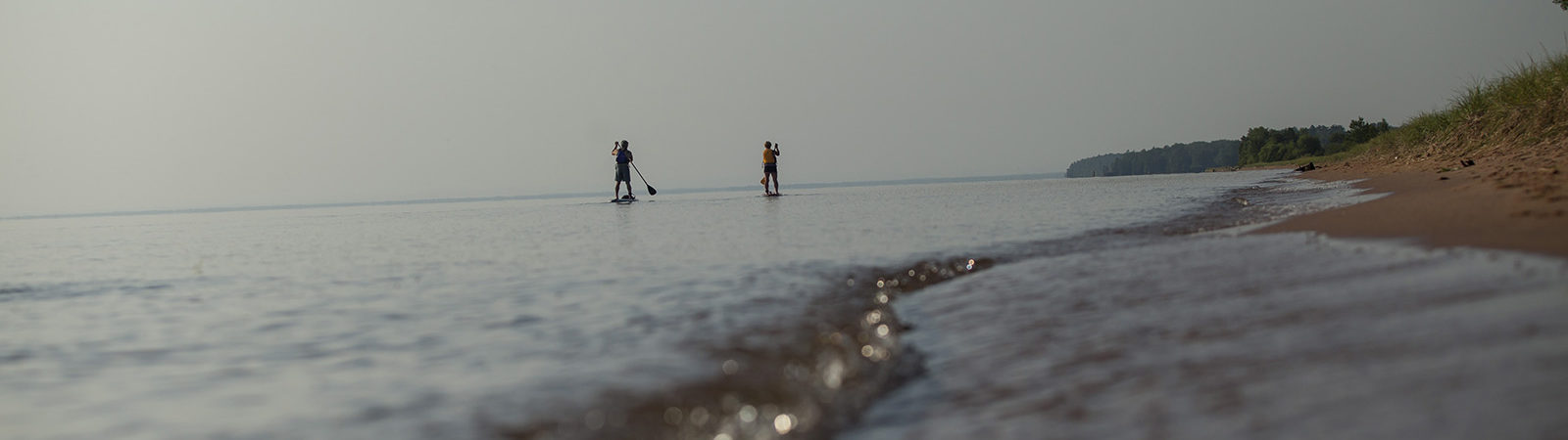 Two paddle boarders on Lake Superior
