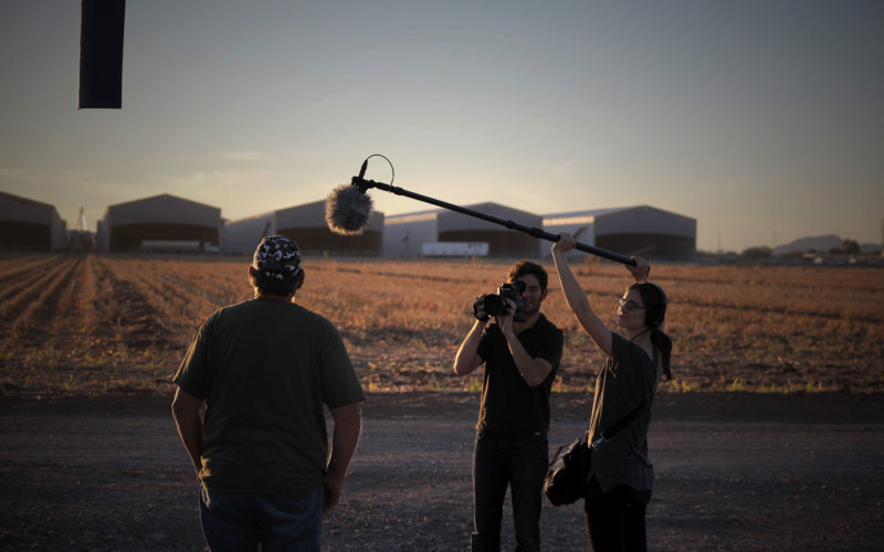 Filmmakers interviewing farmer for doc Right to Harm