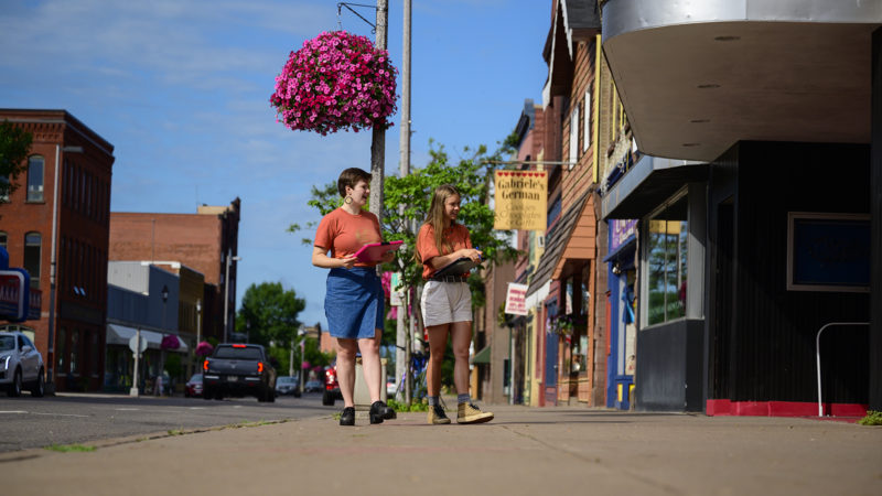 Two Northland College students walking downtown