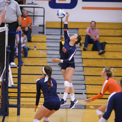 Northland College volleyball player spikes the ball
