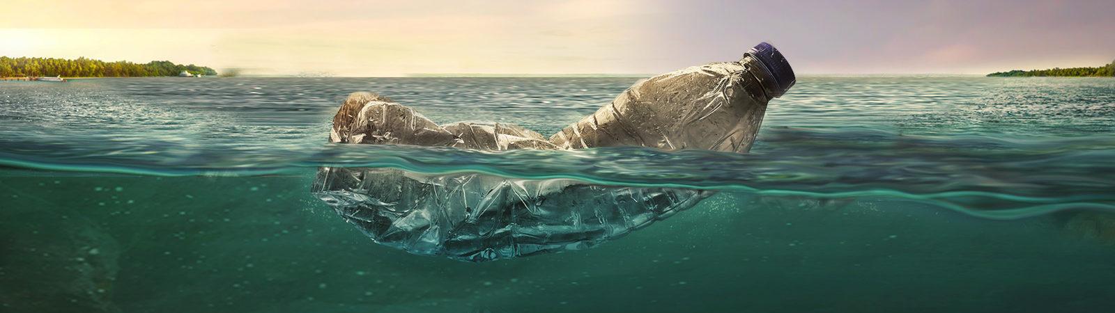 Plastic bottle floating in water.