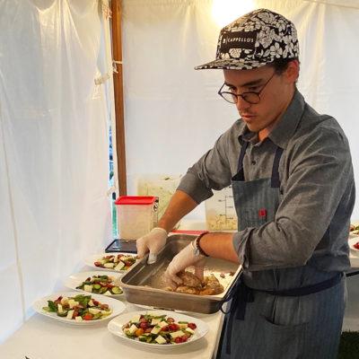 Danny Simpson serving food