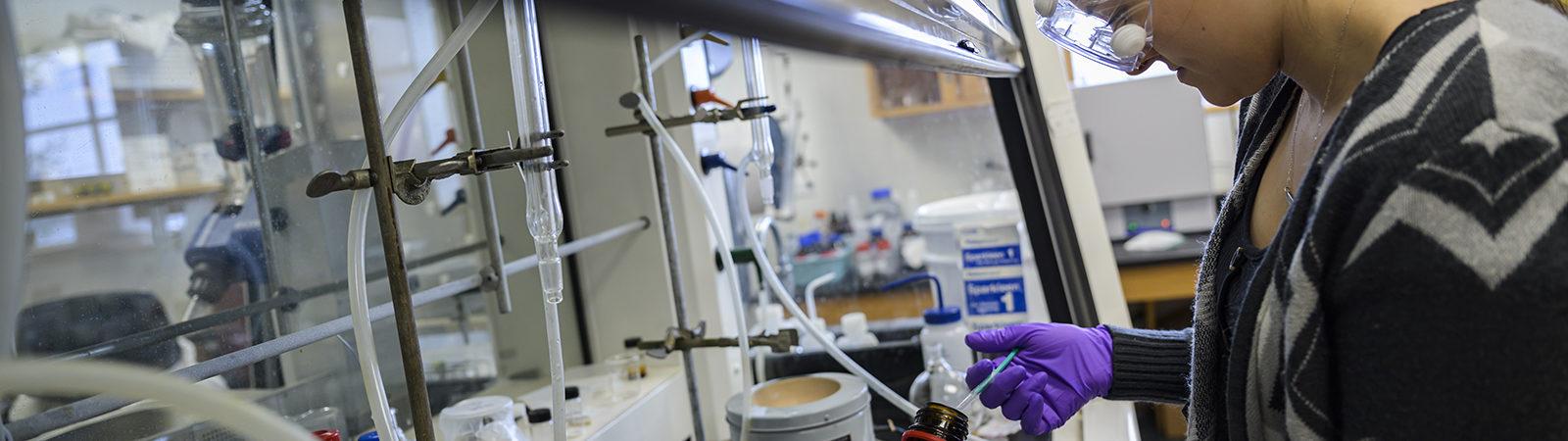 Northland College chemistry student Dakota Stankowski runs trials researching sustainable plastics.