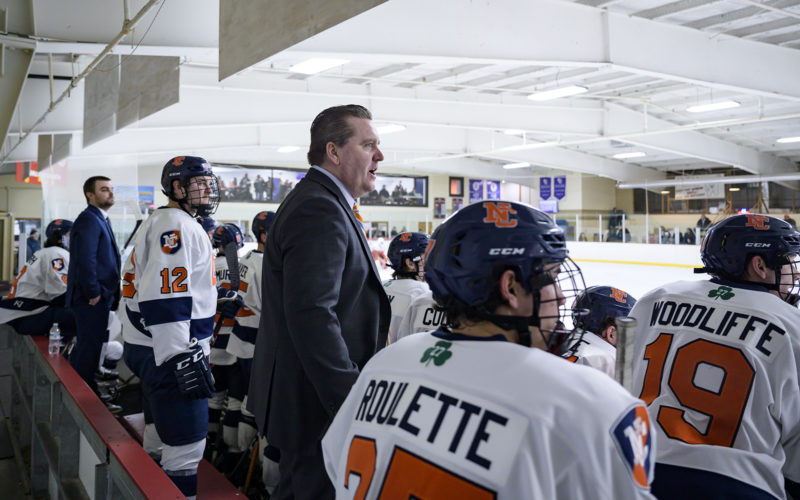Coach Seamus Gregory at hockey game.