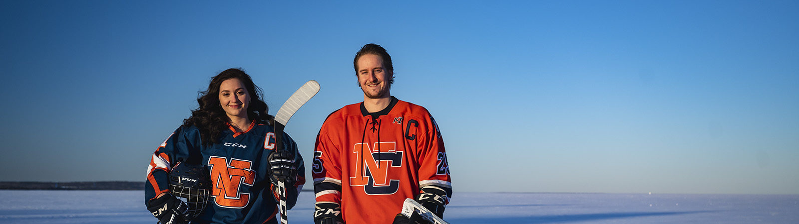Northland College hockey captains stand on Lake Superior.
