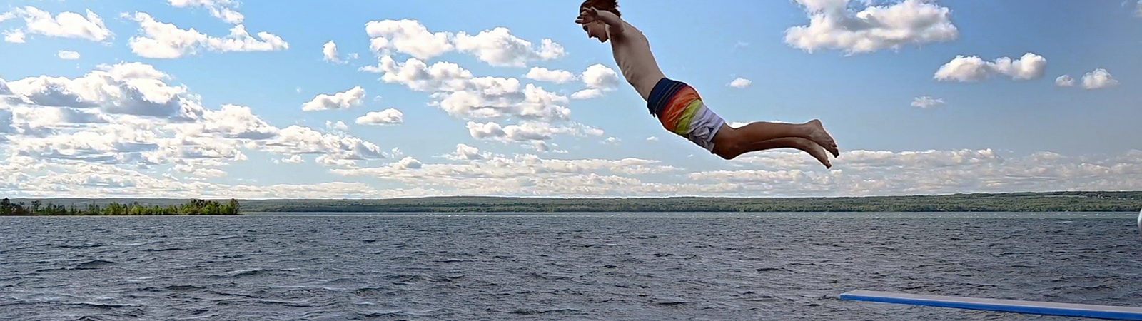 Student diving onto Lake Superior