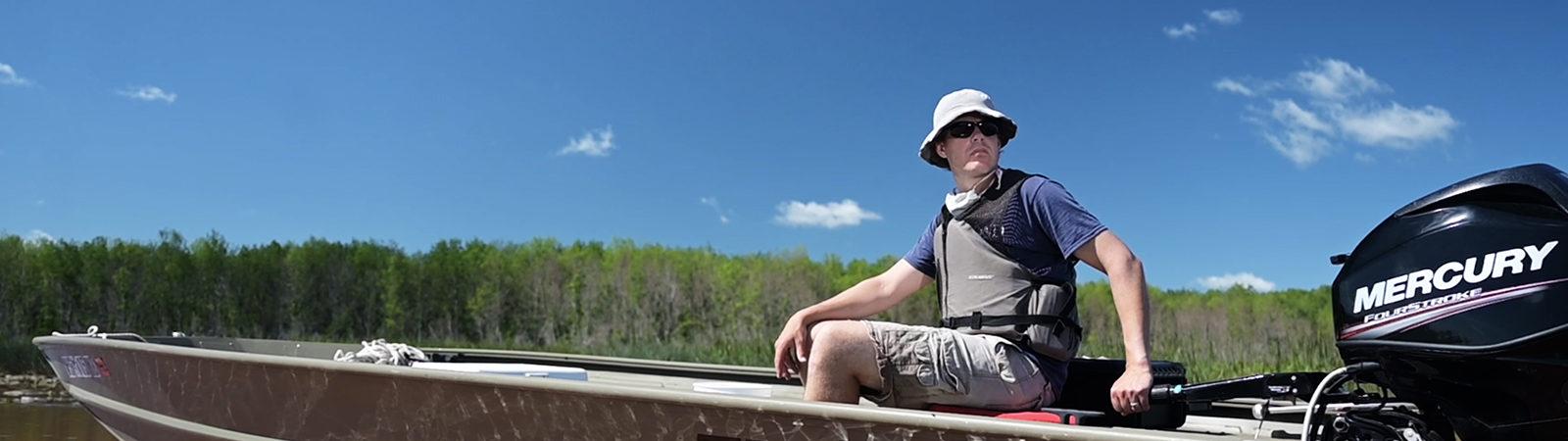 Burke Center researcher Matt Hudson tests for blue-green algae on Lake Superior.