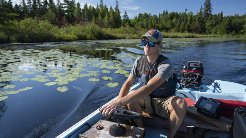 Northland College student Andy Kasun conducts water research.