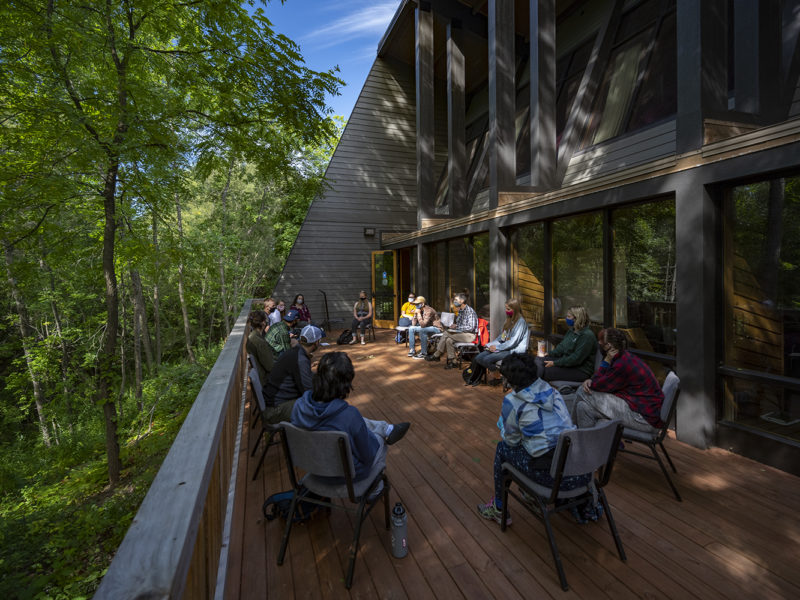 Northland College students meet on the deck of the Sigurd Olson Environmental Institute