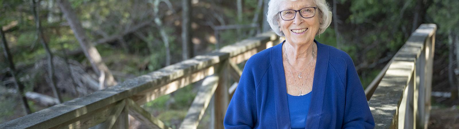 Carolyn Sneed standing on a bridge