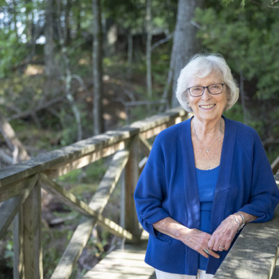 Carolyn Sneed standing on a bridge