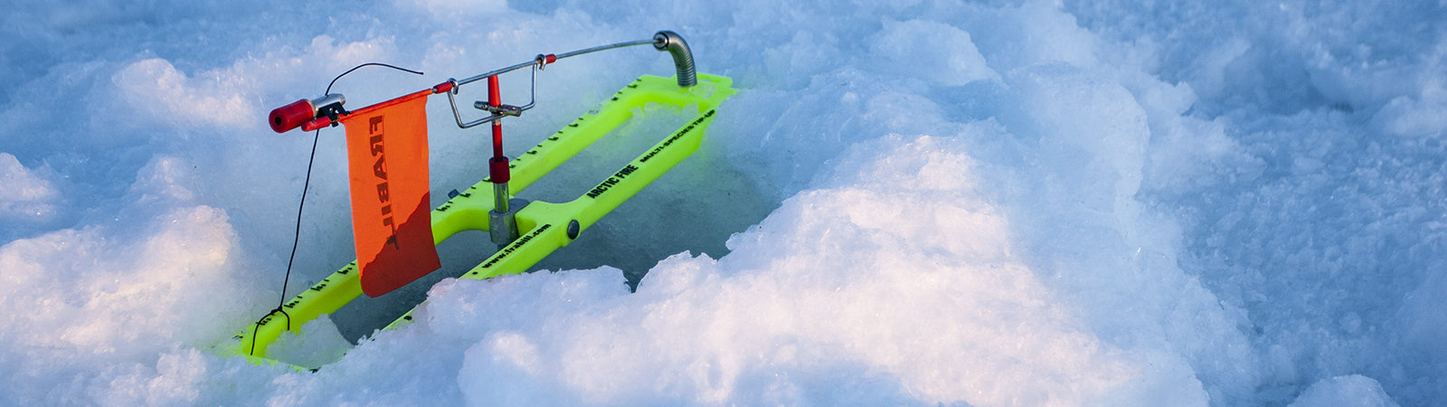 Ice fishing tip up on Lake Superior