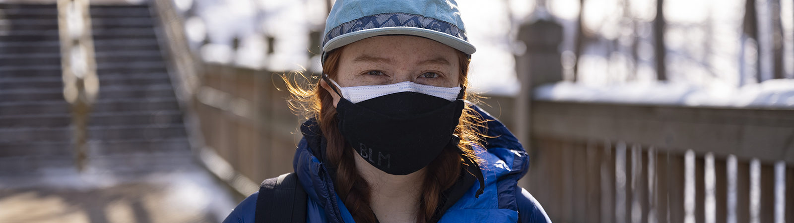 Northland student in winter with mask on.