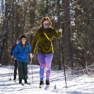 Northland College students ski on campus trails.