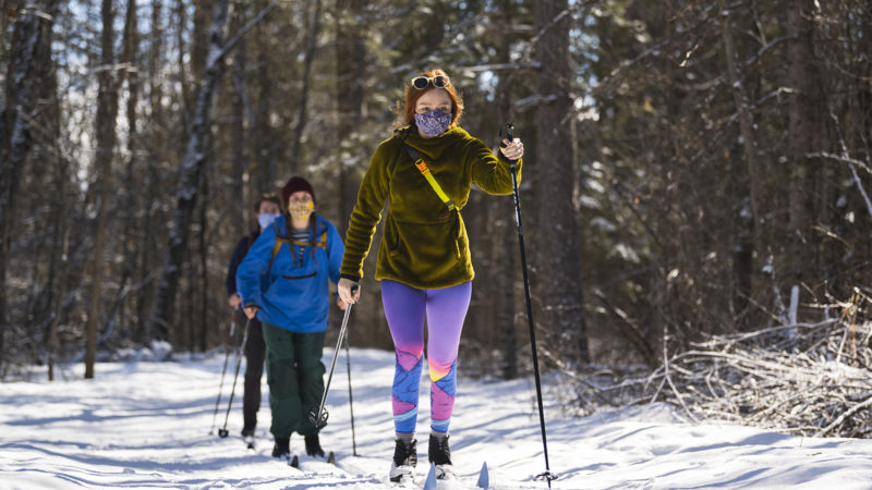 Northland College students ski on campus trails.