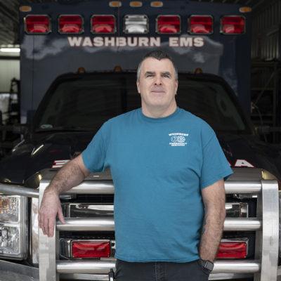 Alum Andy Okey at work at ambulance hall.