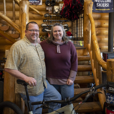Portrait of alums Chris and Judy Young '93 at New Moon Ski and Bike Shop.