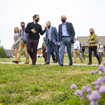 Danny Simpson walks with Governor Tony Evers