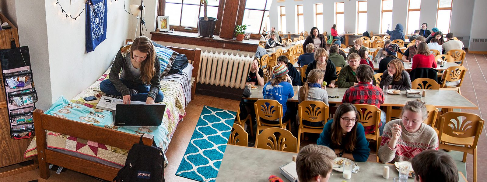 At left, a student studies on a bed in a residence hall room. At left, students gather for lunch in the cafeteria.