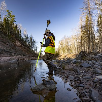 Surveyor collects data on North Fish Creek in northern Wisconsin.